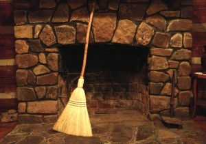 Broom by fireplace