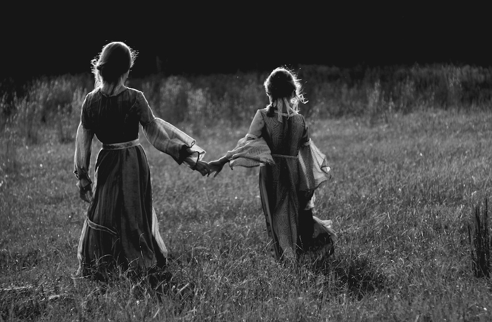 Girls in Meadow Holding Hands